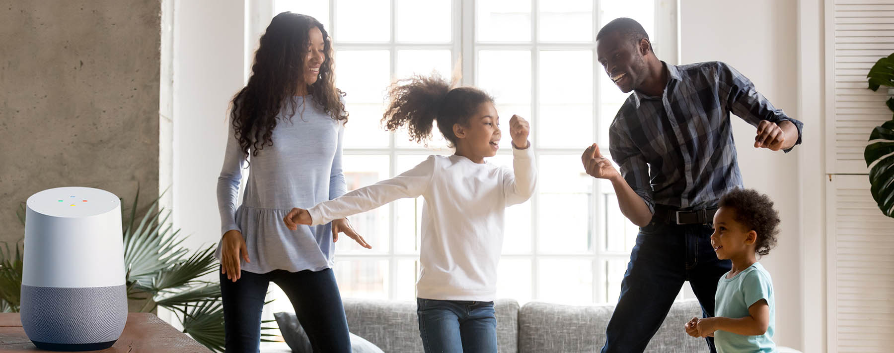 family dancing with Google Home